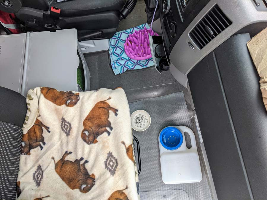 oreo's area in the cab of the van when we're parked, complete with travel water bowl
