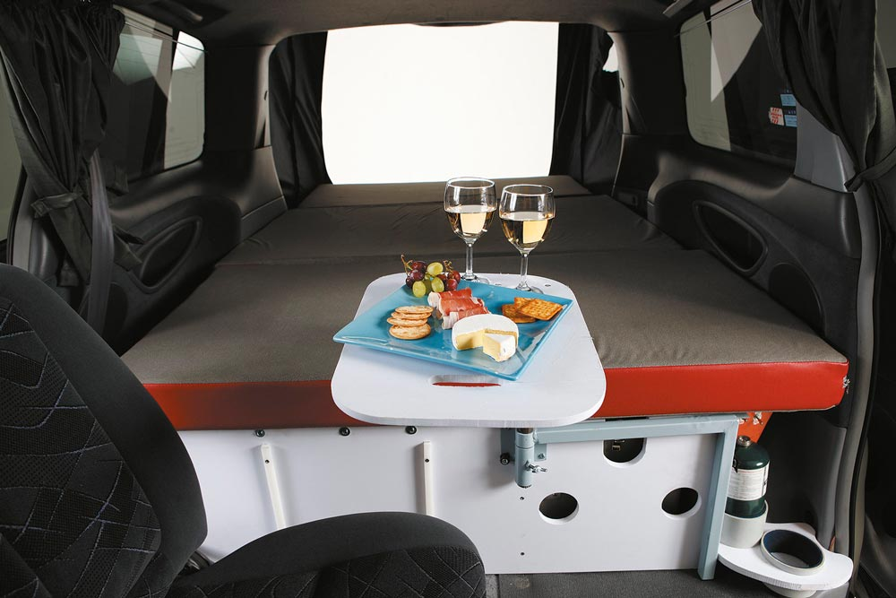 minivan with bed, swivel table and swivel seat