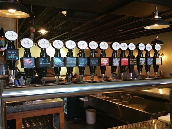 Draft handles at Three Daughters Brewery in St. Pete, FL.