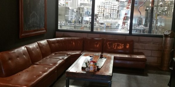 The lounge area overlooking the brewing facility at Coppertail Brewing in Ybor City Tampa
