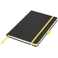 gul anteckningsbok med gravyr