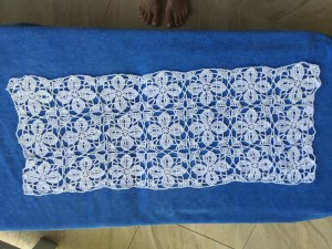 Summer poncho before sewing sides. 3 rows by 7 columns. 21 motifs.