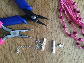 Ribbon clasps ready to clamp onto the crocheted strands