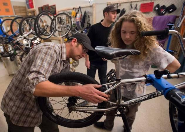 Hall Trost work together on bike photo