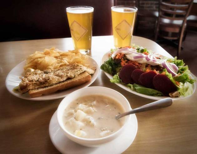 You can't go wrong with a couple of beers over a lunch of seafood chowder, fresh whitefish, and a goatcheese salad with walnuts and beets! (photo by Ron Caspi)