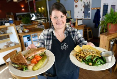 Ann Marie Ede serves up an Orbit Pesto Sandwich and a Quinoa Spinach Salad made fresh at the Sweetwater Cafe Restaurant and Bakery in Marquette Michigan. (marquettemagazine.com photo by Ron Caspi)