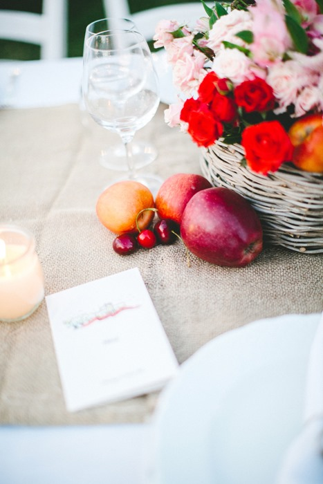 red fruit and flowers for dinner table