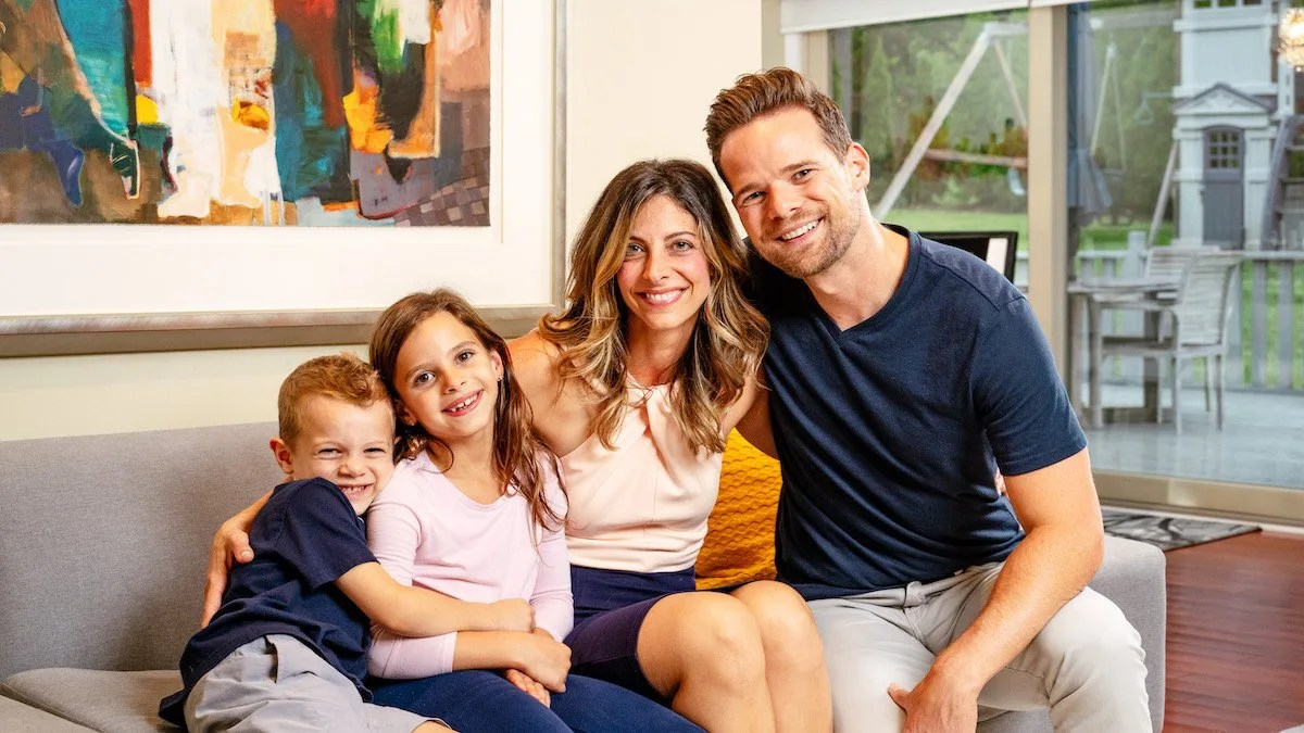 Hill Family Smiling on Couch in Home