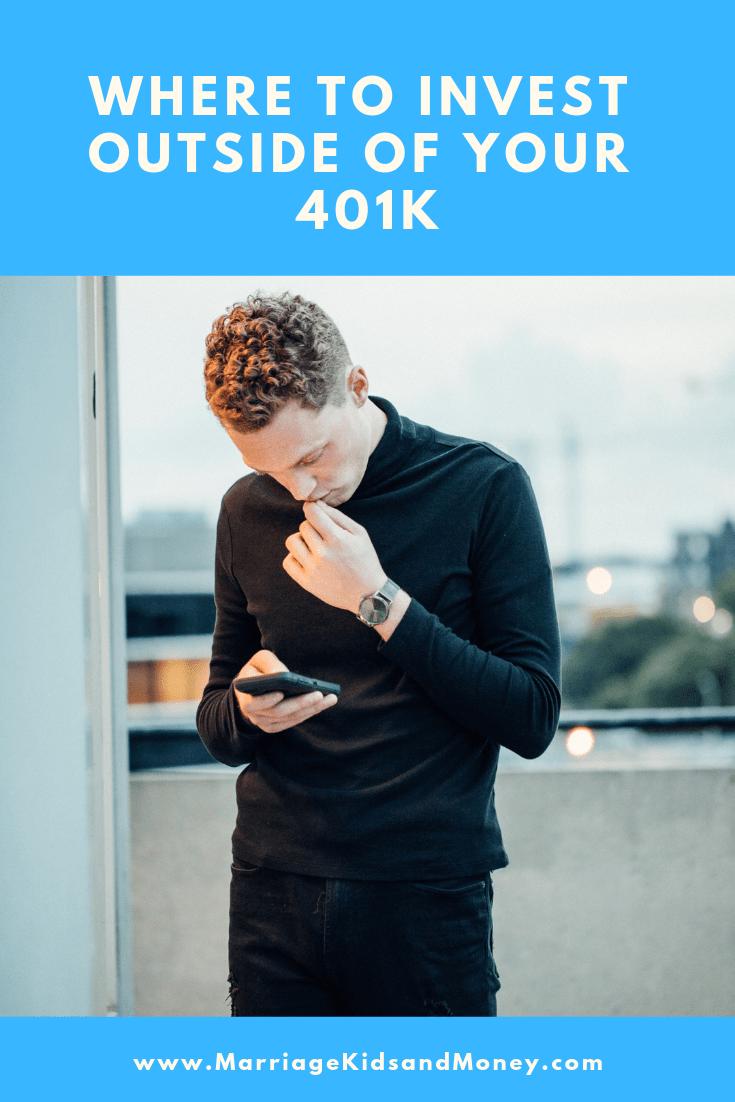 Man looking at phone thinking