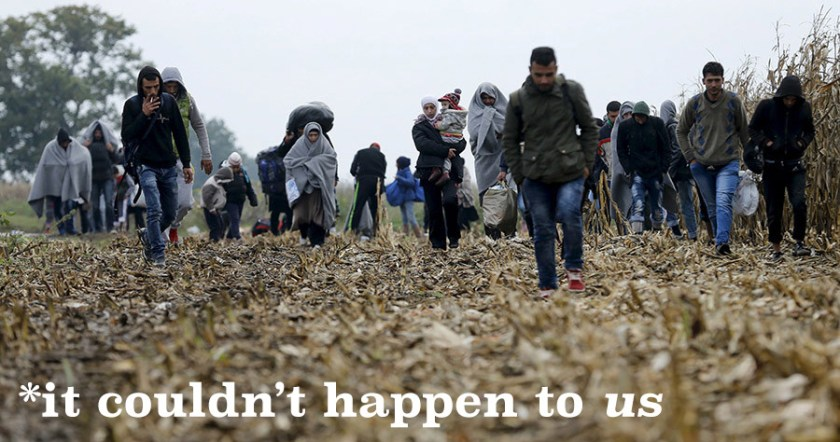 Migrants walk to cross the border into Croatia, near the town of Sid in Serbia