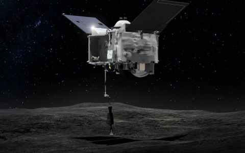 Artist's concept of the OSIRIS REx spacecraft collecting material from Bennu.