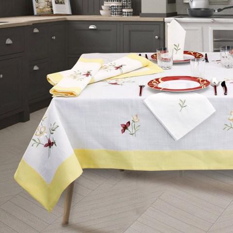 Basilea Completo di Tovaglie con ricamo a fiori e balza in tessuto giallo
