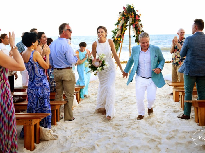 Beach bride and groom exit. Blue Diamond Luxury Boutique Hotel Wedding in Mexico. Martina Campolo Photography
