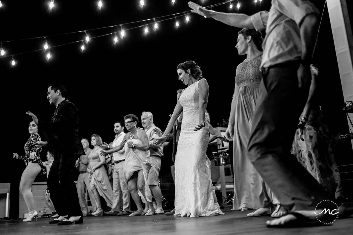 Bride and wedding guests dance at Blue Diamond Luxury Boutique Hotel. Martina Campolo Photography
