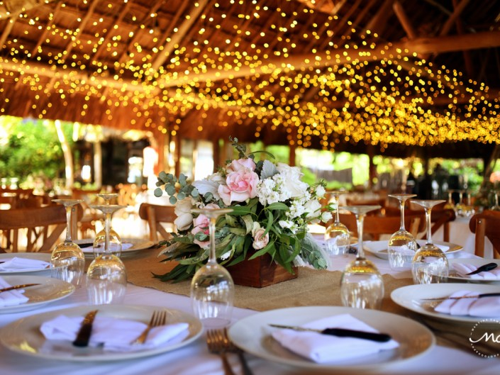 Rustic wedding reception decor with string lights at Blue Venado, Playa del Carmen. Martina Campolo Photography