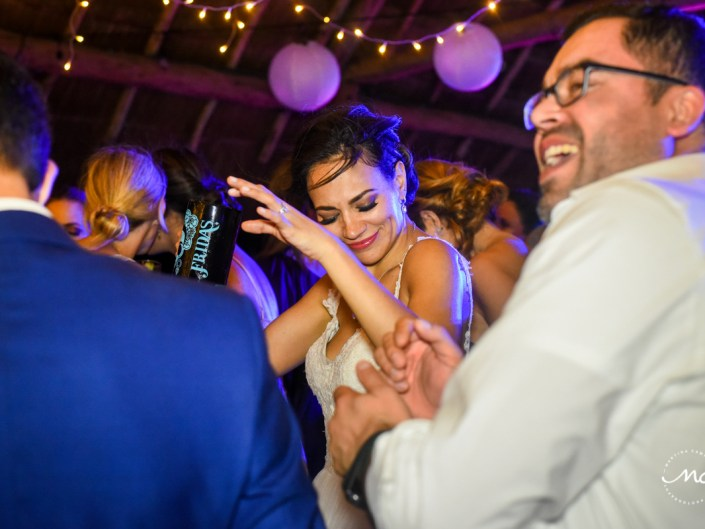 Happy dancing bride at Blue Venado Wedding Reception in Mexico. Martina Campolo Photography