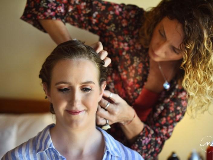 Doranna hairstylist working with bride at Hacienda del Mar, Mexico. Martina Campolo, Destination Wedding Photography