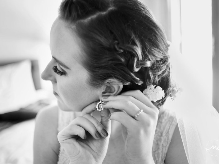 Black and white photo of bride wearing her earrings. Hacienda del Mar wedding in Mexico by Martina Campolo Photography