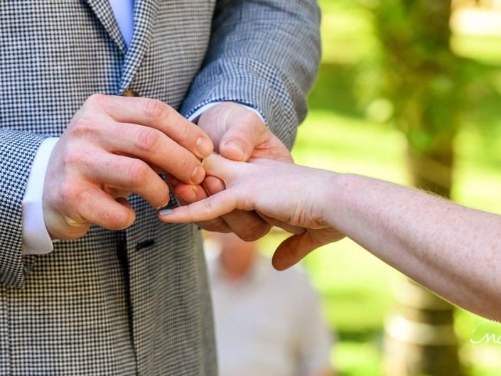 Ring exchange moment at Hacienda del Mar wedding in Puerto Aventuras, Mexico. Martina Campolo Photography