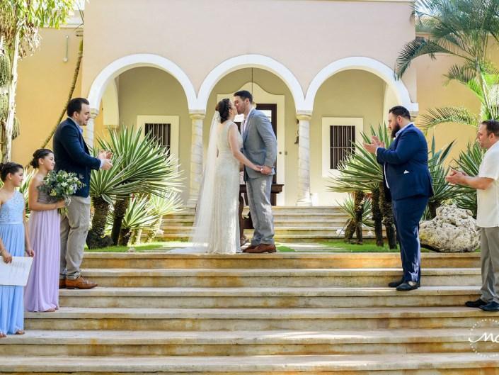 You may kiss the bride moment. Hacienda del Mar garden wedding in Puerto Aventuras, Mexico. Martina Campolo Photography
