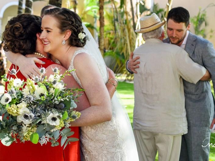 Bride and groom hug guests at Hacienda del Mar wedding in Mexico by Martina Campolo Photography