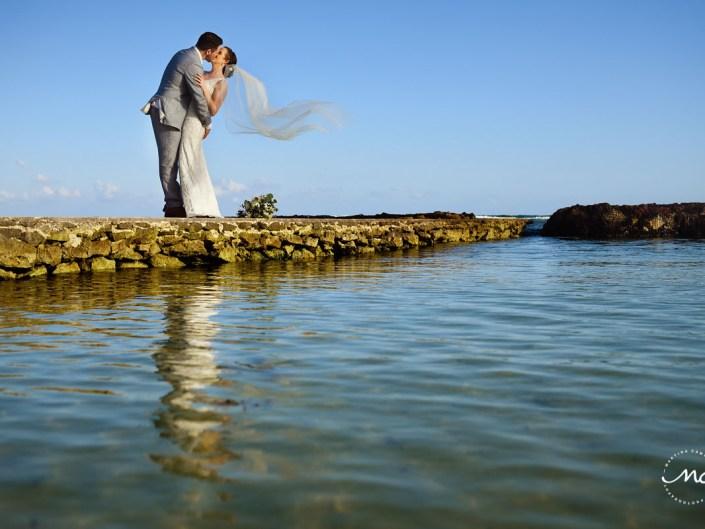 Bride and groom portraits with flying veil on a pier. Hacienda del Mar Wedding in Riviera Maya, Mexico. Martina Campolo Photography