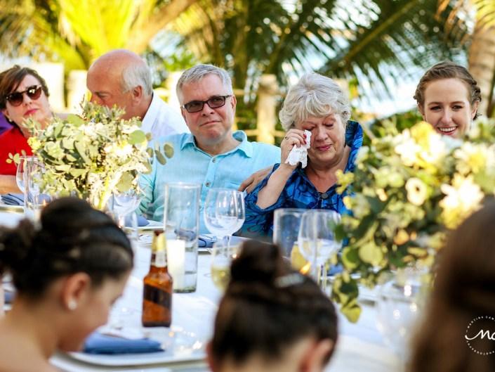 Wedding reception table with guests. Hacienda del Mar destination wedding in Mexico by Martina Campolo Photography