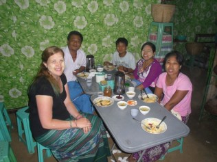Dinner with my tour guide's family - that's him in the blue lonyi