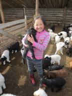 A little girl with a baby goat!