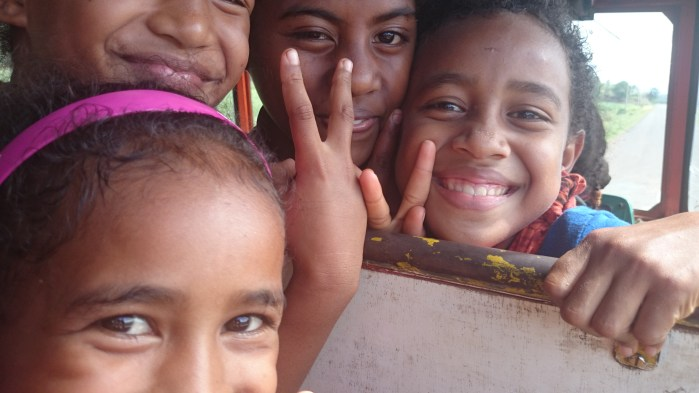 """Take my picture! And mine!"" School kids on the bus near Labasa, Fiji."