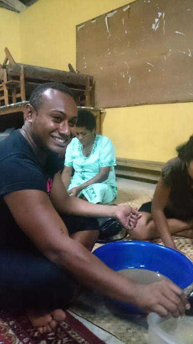 Pisa serving me kava in the community hall