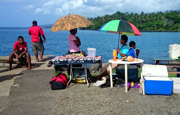 Selling roti and coconuts on the wharf