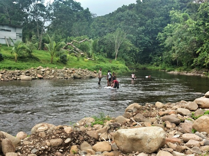 Kids swimming in the river