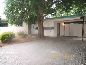 Front of home with carport and there is a shop area back of carp