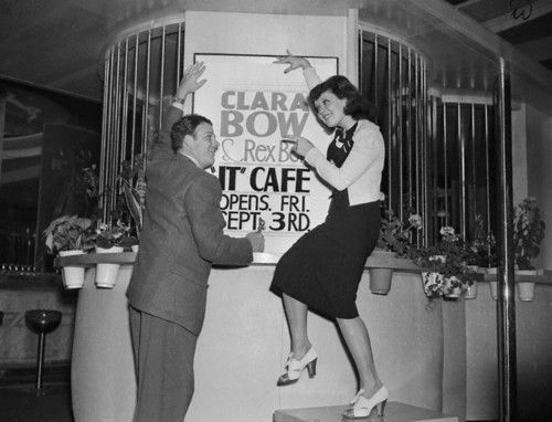 "Clara Bow and Rex Bell getting ready to open the ""It"" Café in 1937"