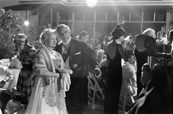 Francis X. Bushman and his wife at the Garden of Allah's closing party, 1959