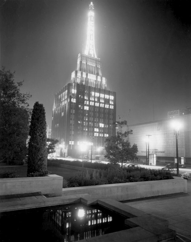 The Richfield Tower as seen from the Flower Street reflecting pool of the Los Angeles Central Library, 1950s.