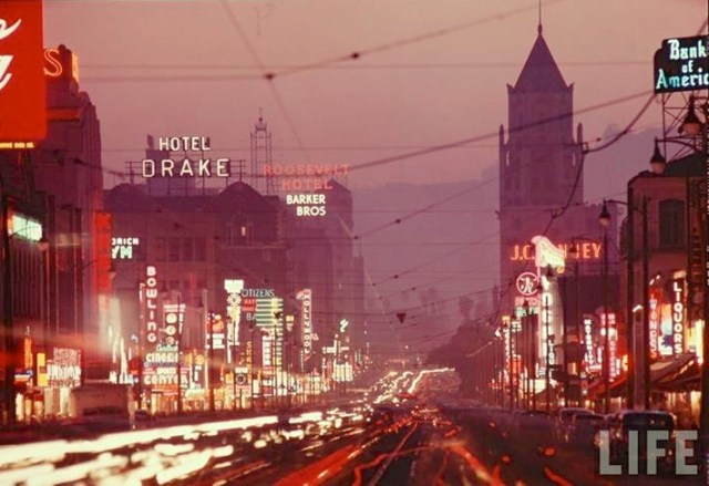 Looking west down busy Hollywood Blvd at dusk, Los Angeles, 1951