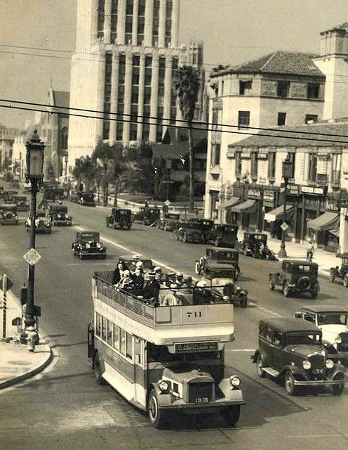 A roofless Los Angeles Motor Coach Bus on Wilshire Blvd, circa 1930s