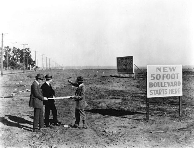 Three men discussing a road project that would eventually become Santa Monica Blvd, probably Westwood, 1922.