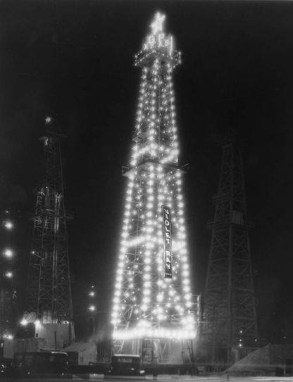 Oil derrick decorated for the holiday season, Santa Fe Springs, 1929