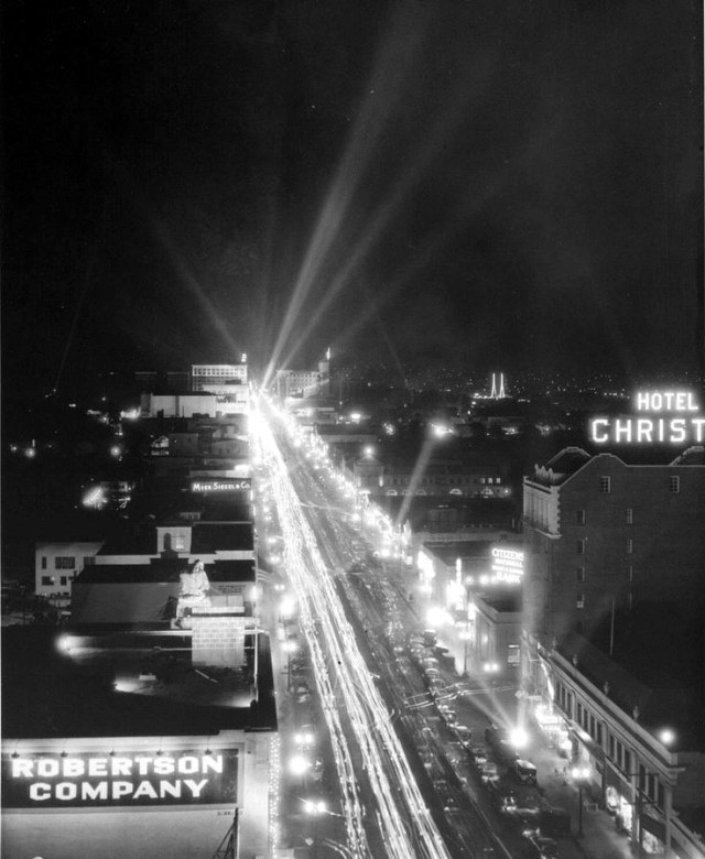 Aerial view of Hollywood Boulevard at night, looking east from Highland Avenue, circa 1930s