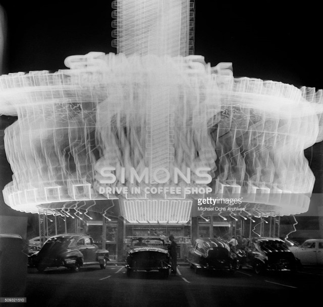 Stylized night shot of Simon's Drive-In, corner of Wilshire Blvd and Fairfax Ave, Los Angeles