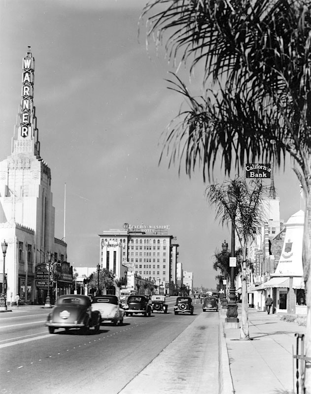 Looking west along Wilshire Blvd, Beverly Hills toward the Warner Bros Theatre, 1937