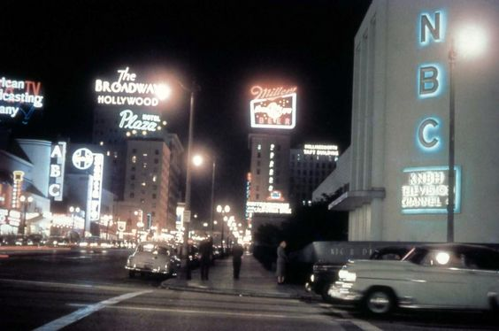 Color evening view looking north on Vine St. from Sunset Boulevard, 1950s.