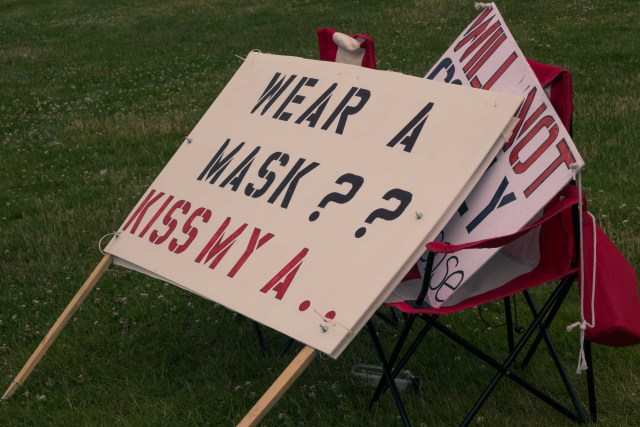 anti-mask protest sign