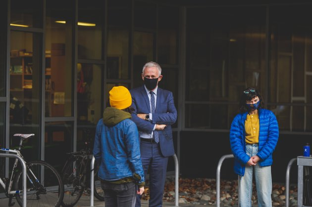 president hall meets with divest uvic mural organizers