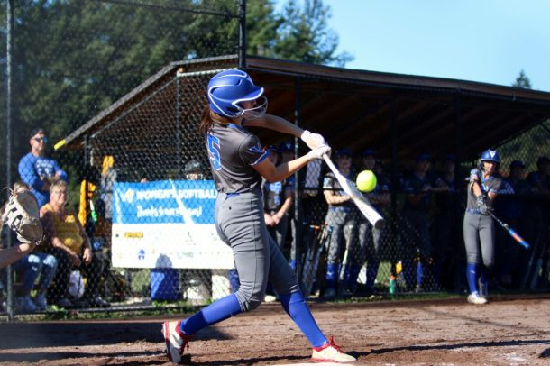 A hitter from the UVic Vikes women's softball team. Photo by Captured Sports Photography,