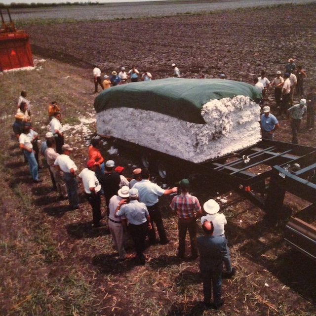 Farmer and company owners visit Texas to see a new mode of collecting and moving cotton.