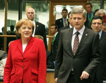 Stephen Harper (right) is heading a government with record number of female ministers but this has not improved the situation for women. The same can be said for Germany's first female Prime Minister, who has presided over huge cuts in the welfare state. Photo by franz88 on Flickr.